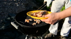 Shrimps on the grill - getting turned Stock Footage