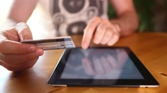 Typing credit card numbers to buy online on Ipad, Tablet PC - stock footage