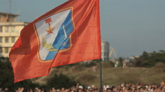 Flag of Sevastopol fly over the crowd Stock Footage