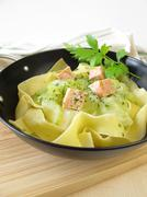 Pasta with cucumber and salmon in wok Stock Photos