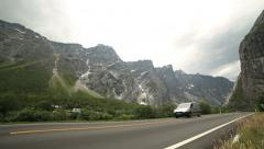 Cars passing by at Troll Wall Mountains Norway - stock footage