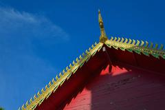 Golden gable on the roof architecture of northern thailand in temple buddhism Stock Photos