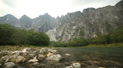 Troll Wall Mountain view from river Rauma slider shot - stock footage
