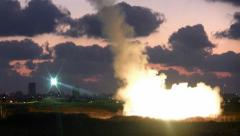 Iron Dome missile intercepts Hamas rocket, night vision shot - stock footage