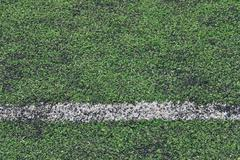 artificial green grass soccer field made with plastic and rubber - stock photo