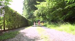 Three Asian Children Running Towards Camera On Summer Path Stock Footage