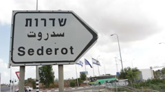 Sderot sign with Israeli flags Stock Footage