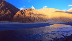 Nubra river at gold sunset Stock Footage