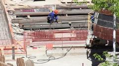 Welder welding metal on construction site Stock Footage