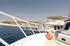 Wide-angle view of a white dive-boat's bow. Stock Photos