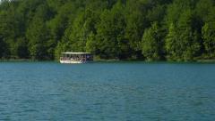Visitor boat at Plitivice Lakes National Park, Croatia Stock Footage