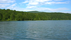 Tranquil lake and forest Stock Footage