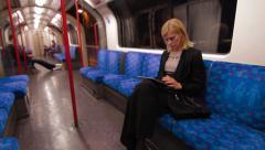Digital tablet on London Underground train Stock Footage