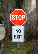 Stop and no exit signs Stock Photos