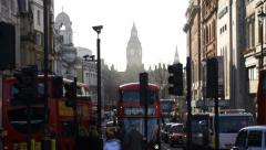 London street with red buses & Big Ben Stock Footage