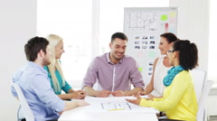 team with hands on top of each other in office - stock footage