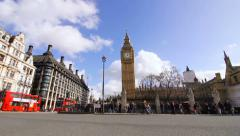 Big Ben and Traffic streaming past Houses of Parliament, London - Stock Footage