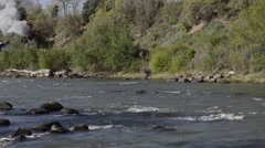Historic steam train passing river-cropped-HD-P-2247 Stock Footage