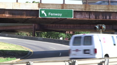 Cars driving on the Fenway Exit off of Storrow Drive in Boston Stock Footage