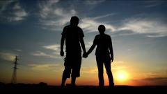 Lovers on a date in sunset, holding hands. Romantic love scene Stock Footage