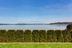 Stock Photo of beautiful view of bay and trimmed hedges