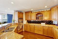 Kitchen room interior in modern apartment Stock Photos