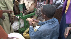 African man counting money at market, Stock Footage