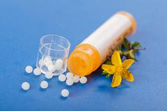 Homeopathic pills and hypericum Stock Photos