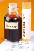 Allium cepa plant extract, homeopathic pills on sheet Stock Photos