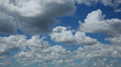 Billowy Clouds Sweep Across Sky, Time Lapse - stock footage