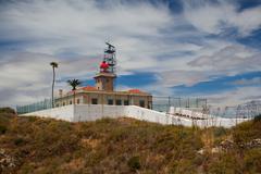 ponta de piedade lighthouse overlooking the atlantic ocean,lagos,algarve,port - stock photo