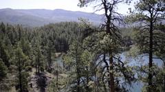 Historic steam train passes a small lake in Colorado Rockies-POV-HD P-1829 Stock Footage