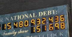 Stock Video Footage of 4K National Debt Clock Establishing Shot Flash Zooms
