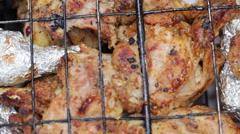 Chicken legs on open fire Stock Footage