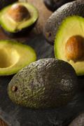 Organic raw green avocados Stock Photos