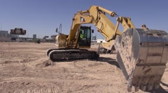 Hydraulic Excavator Turning - Active Construction Site Stock Footage