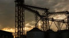Silhouette of grain silo sunrise, Time lapse Stock Footage