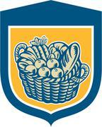 Crop harvest basket shield woodcut Stock Illustration