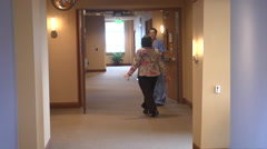 two nurses enter hospital ward as doors open - stock footage