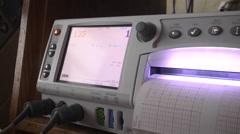 nurse sets ultrasound machine for use closeup - stock footage