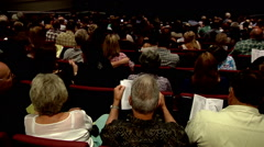 Audience people sitting theater arts lifestyle entertainment cutaway crowd Stock Footage