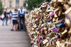 locks of pont des arts in paris, france - love bridge - stock photo