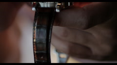 4k Macro of man looking at watch with loupe Stock Footage