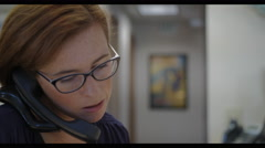 Medical Receptionist on Phone Stock Footage
