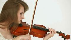 Caucasian violinist girl on a white background. Closeup profile. Stock Footage
