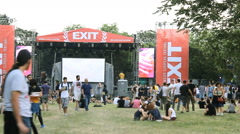 concert crowd  on music festival at grass field,at the concert  dancing music - stock footage
