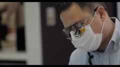 4k Orthodontist wearing mask Stock Footage