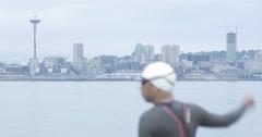 4k Swimmer Warmup Seattle Skyline Stock Footage