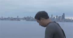 Swimmer applying cap with Seattle background Stock Footage