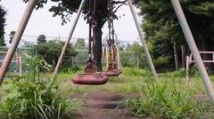 Park swings gently swinging Stock Footage